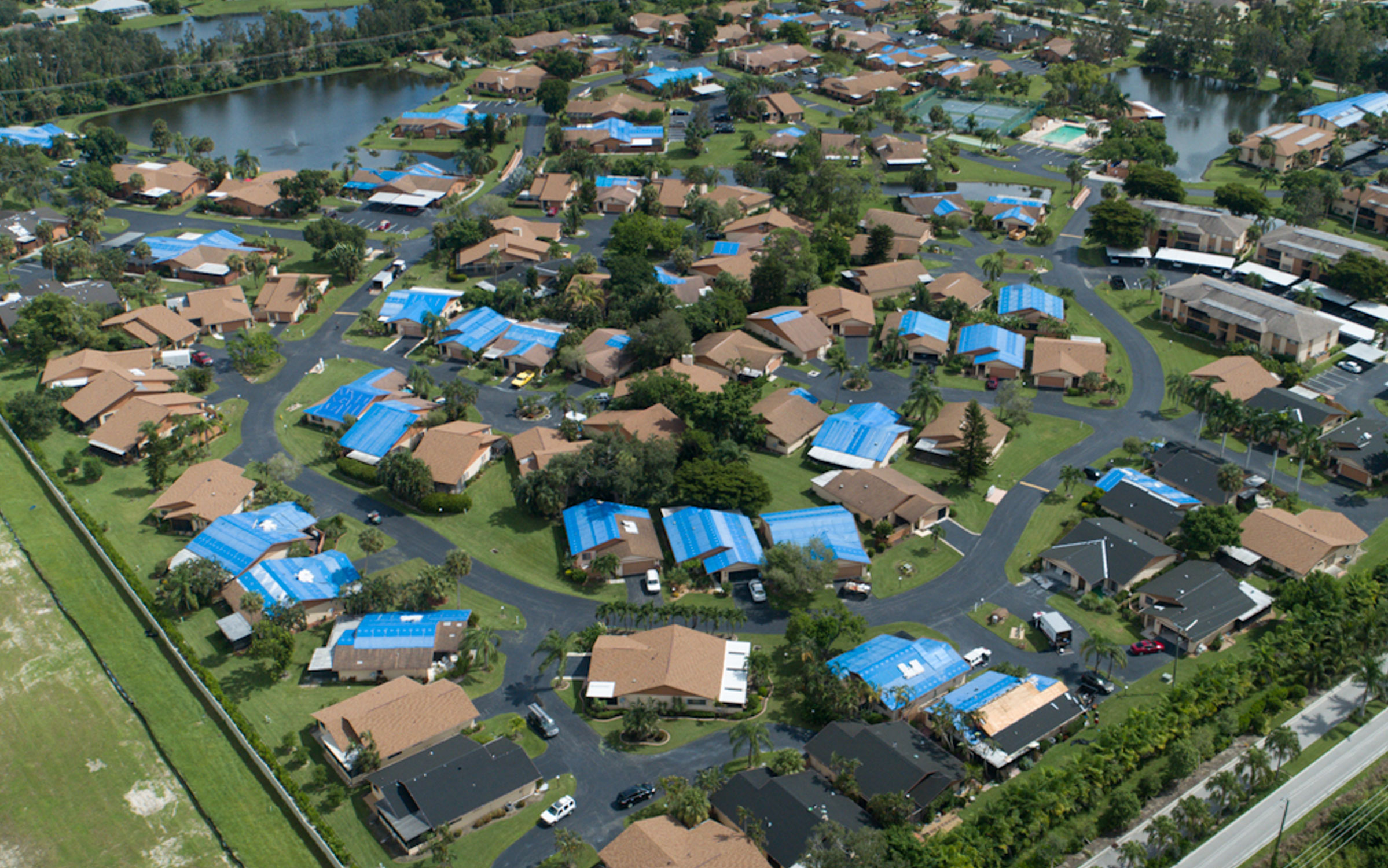 Drone shot of HOA with roofs under construction being repair